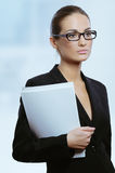 Young attractive business woman with contract documents in her hand Royalty Free Stock Images