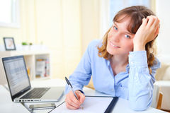 Young attractive business woman copying data on paper Stock Photos