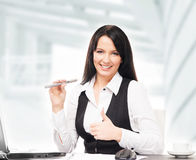 Young and attractive business woman with an electronic cigarette Stock Photo