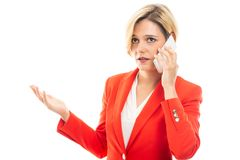 Young attractive business woman explaining on mobile phone royalty free stock photo
