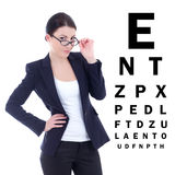 Young attractive business woman in eyeglasses and eye test chart Royalty Free Stock Images