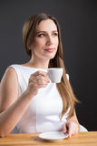 Young attractive business woman having coffee cup Royalty Free Stock Image