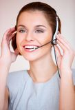 Young attractive business woman with headset Stock Photography