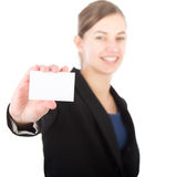 Young attractive business woman holdin a blank card. With focus on the card Stock Images