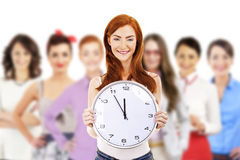 Young attractive business woman holding clock Stock Photo
