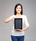 Young and attractive business woman holding a tablet Stock Images