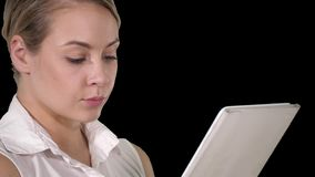 Young attractive business woman holding a tablet computer, Alpha Channel. On Alpha Matte. Close up. Young attractive business woman holding a tablet computer stock video