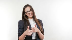 Young attractive business woman holding thumbs up stock video footage