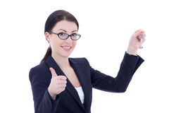 Young attractive business woman with key in hand thumbs up isola Royalty Free Stock Image