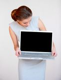 Young attractive business woman with laptop Royalty Free Stock Photography