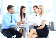 Young attractive business woman in a meeting Royalty Free Stock Image