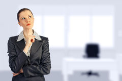Young attractive business woman in the office Royalty Free Stock Photo