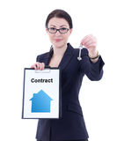 Young attractive business woman showing clipboard with contract Stock Photo