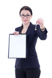 Young attractive business woman showing clipboard and metal key Stock Photos