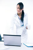 Young attractive business woman using laptop at the office Royalty Free Stock Photos