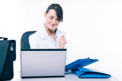 Young attractive business woman using laptop at the office Stock Photography