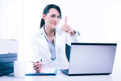 Young attractive business woman using laptop at the office Royalty Free Stock Image