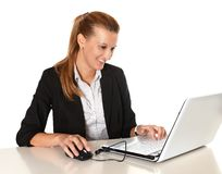 Young Attractive Business Woman working in Computer stock photo