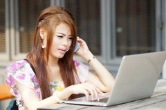 Young attractive business woman working on her laptop at outdoor Stock Photo