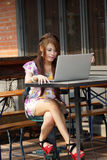 Young attractive business woman working on her laptop at outdoor Stock Images