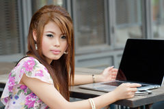 Young attractive business woman working on her laptop at outdoor Stock Photos