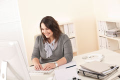 Young attractive business woman working at office. With computer Royalty Free Stock Photos