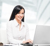 Young and attractive business woman working in office Stock Photo