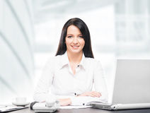 Young and attractive business woman working in office stock photos