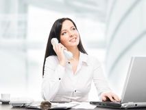 Young and attractive business woman working in office Stock Image