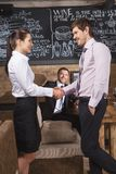 Young attractive businessman and businesswoman at cafe. Stock Photos