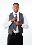 Young attractive businessman corrects a tie Stock Photos
