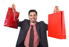Young attractive businessman holding shopping bags in sale and market opportunity concept Stock Photos