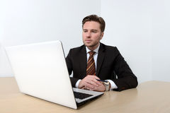 Young attractive businessman looking at computer Stock Photography