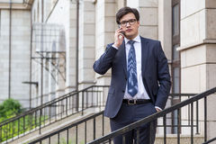 Young attractive businessman on phone Royalty Free Stock Image