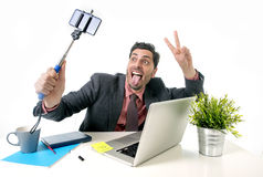 Young attractive businessman in suit and tie taking selfie photo Stock Photos
