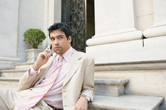 Businessman speaking on cell phone. Stock Photos