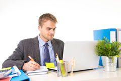 Young attractive businessman working busy with laptop computer at office desk smiling looking satisfied Stock Photos