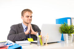 Young attractive businessman working busy with laptop computer at office desk smiling looking satisfied Royalty Free Stock Photos
