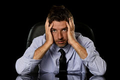 Young attractive businessman in worried tired and stressed face expression sitting depressed on office chair Royalty Free Stock Photography