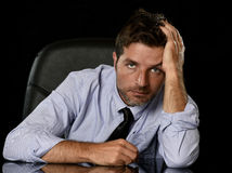 Young attractive businessman in worried tired and stressed face expression sitting depressed on office chair Royalty Free Stock Image