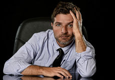 Young attractive businessman in worried tired and stressed face expression sitting depressed on office chair Stock Images
