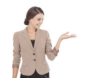 Young attractive businessswoman standing while presenting copy s Stock Photography