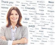 Young and attractive businesswoman on a background with words Royalty Free Stock Images