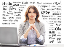 Young and attractive businesswoman on a background with words Stock Photos