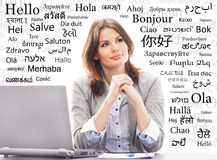 Young and attractive businesswoman on a background with words Stock Image