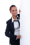 Young attractive businesswoman behind the wall Royalty Free Stock Image