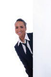 Young attractive businesswoman behind the wall Royalty Free Stock Photography