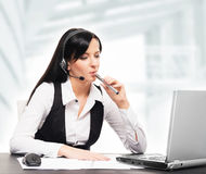 Young and attractive businesswoman with an electronic cigarette Stock Photos