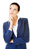 Young attractive businesswoman. Face expression. Thinking. Stock Photo