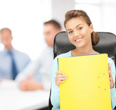 Young attractive businesswoman with folders Royalty Free Stock Photos